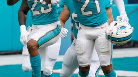Miami Dolphins strong safety Jordan Lucas (21) congratulates cornerback Xavien Howard (25), after Howard intercepted a pass and ran it for a touchdown, during the first half of an NFL football game against the Denver Broncos, Sunday, Dec. 3, 2017, in Miami Gardens, Fla. (AP Photo/Wilfredo Lee)