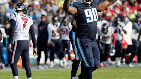 Tennessee Titans defensive end DaQuan Jones (90) celebrates after a 48-yard field goal attempt by Houston Texans kicker Ka'imi Fairbairn (7) was no good in the first half of an NFL football game Sunday, Dec. 3, 2017, in Nashville, Tenn. (AP Photo/James Kenney)