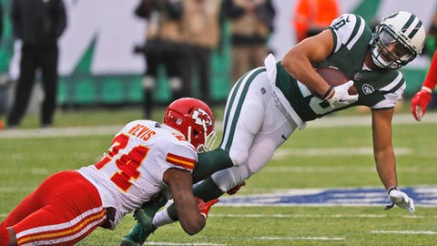 Kansas City Chiefs' Darrelle Revis, left, tackles New York Jets' Jermaine Kearse during the first half of an NFL football game, Sunday, Dec. 3, 2017, in East Rutherford, N.J. (AP Photo/Julie Jacobson)