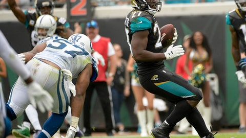Jacksonville Jaguars running back Leonard Fournette, right, runs for a 5-yard touchdown past Indianapolis Colts outside linebacker Barkevious Mingo (52) during the second half of an NFL football game, Sunday, Dec. 3, 2017, in Jacksonville, Fla. (AP Photo/Phelan M. Ebenhack)
