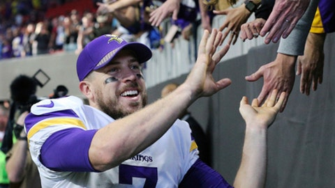 Vikings quarterback Case Keenum celebrates a 14-9 victory over the Falcons with fans in a NFL football game on Sunday, Dec.3, 2017, in Atlanta. (Curtis Compton/Atlanta Journal-Constitution via AP)
