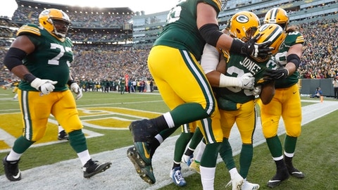 Green Bay Packers' Aaron Jones celebrates his touchdown run with teammates during overtime of an NFL football game against the Tampa Bay Buccaneers Sunday, Dec. 3, 2017, in Green Bay, Wis. The Packers won 26-20. (AP Photo/Mike Roemer)