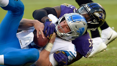 Detroit Lions quarterback Matthew Stafford is sacked by Baltimore Ravens outside linebacker Terrell Suggs in the second half of an NFL football game, Sunday, Dec. 3, 2017, in Baltimore. (AP Photo/Nick Wass)