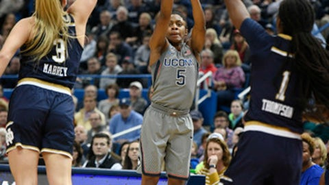 Connecticut's Crystal Dangerfield shoots as Notre Dame's Marina Mabrey, left, and Lili Thompson defend during the first half an NCAA college basketball game Sunday, Dec. 3, 2017, in Hartford, Conn. (AP Photo/Jessica Hill)