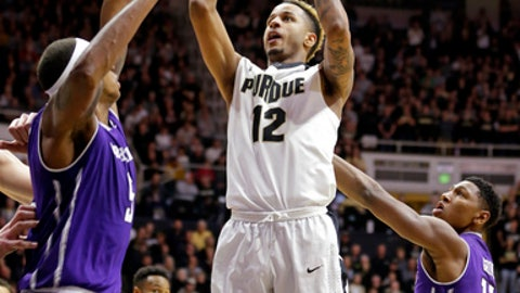 Purdue forward Vincent Edwards (12) shoots over Northwestern center Dererk Pardon (5) during the second half of an NCAA college basketball game in West Lafayette, Ind., Sunday, Dec. 3, 2017. Purdue defeated Northwestern 74-69. (AP Photo/Michael Conroy)