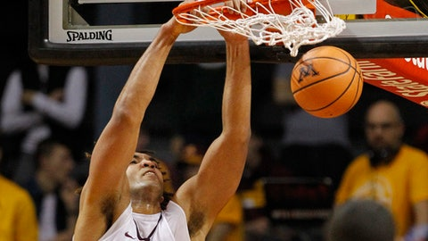 Minnesota center Reggie Lynch dunks against Rutgers during the first half of an NCAA college basketball game Sunday, Dec. 3, 2017, in Minneapolis. (AP Photo/Bruce Kluckhohn)