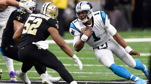 Carolina Panthers quarterback Cam Newton (1) carries under pressure from New Orleans Saints outside linebacker Craig Robertson (52) in the second half of an NFL football game in New Orleans, Sunday, Dec. 3, 2017. (AP Photo/Bill Feig)