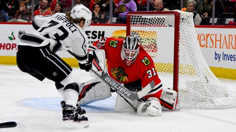 Los Angeles Kings center Tyler Toffoli (73) shoots against Chicago Blackhawks goalie Anton Forsberg (31) during the first period of an NHL hockey game Sunday Dec. 3, 2017, in Chicago. (AP Photo/Matt Marton)
