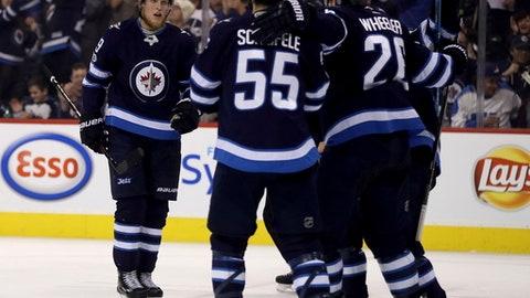 Winnipeg Jets' Patrik Laine (29) skates towards his teammates after scoring against the Ottawa Senators during the second period of an NHL hockey game in Winnipeg, Manitoba, Sunday, Dec. 3, 2017. (Trevor Hagan/The Canadian Press via AP)