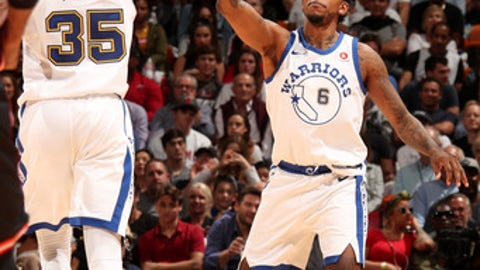 MIAMI, FL - DECEMBER 3: Kevin Durant #35 exchanges a high five with teammate Nick Young #6 of the Golden State Warriors during the game against the Miami Heat on December 3, 2017 in Miami Florida. NOTE TO USER: User expressly acknowledges and agrees that, by downloading and or using this photograph, User is consenting to the terms and conditions of the Getty Images License Agreement. Mandatory Copyright Notice: Copyright 2017 NBAE (Photo by Issac Baldizon/NBAE via Getty Images)