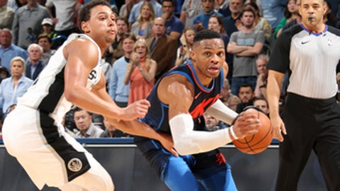 OKLAHOMA CITY, OK- DECEMBER 3:  Russell Westbrook #0 of the Oklahoma City Thunder handles the ball against the San Antonio Spurs on December 3, 2017 at Chesapeake Energy Arena in Oklahoma City, Oklahoma. NOTE TO USER: User expressly acknowledges and agrees that, by downloading and or using this photograph, User is consenting to the terms and conditions of the Getty Images License Agreement. Mandatory Copyright Notice: Copyright 2017 NBAE (Photo by Layne Murdoch Jr./NBAE via Getty Images)