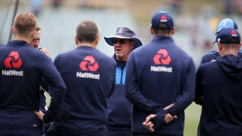 England's head coach Trevor Bayliss talks with his players before the start of the third day of their Ashes cricket test match in Adelaide, Monday, Dec. 4, 2017. (AP Photo/Rick Rycroft)
