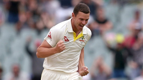 Australia's Josh Hazlewood celebrates taking the wicket of England's James Vince for 2 runs during the third day of their Ashes cricket test match in Adelaide, Monday, Dec. 4, 2017. (AP Photo/Rick Rycroft)