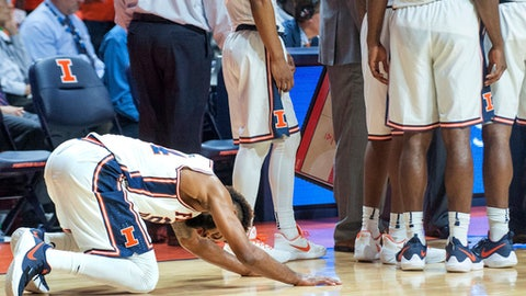 Illinois guard Mark Alstork (24) reacts after watching a replay of his foul in the final second of Illinois' 92-91 loss to Maryland in overtime in an NCAA college basketball game in Champaign, Ill., Sunday, Dec. 3, 2017. (AP Photo/Robin Scholz)