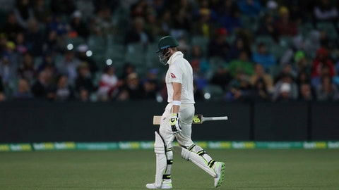 Australia's Steve Smith leaves the playing field after he was trapped LBW out for 6 runs against England during the third day of their Ashes cricket test match in Adelaide, Monday, Dec. 4, 2017. (AP Photo/Rick Rycroft)