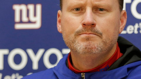 FILE - In this Nov. 24, 2017, file photo, New York Giants head coach Ben McAdoo listens to a question during a press conference after an NFL football game against the Washington Redskins in Landover, Md. McAdoo has been fired as coach of the New York Giants less than a year after taking the team to the playoffs for the first time since 2011.  The firing of the second-year coach was announced by the team Monday, Dec. 4, 2017. (AP Photo/Mark Tenally, File)