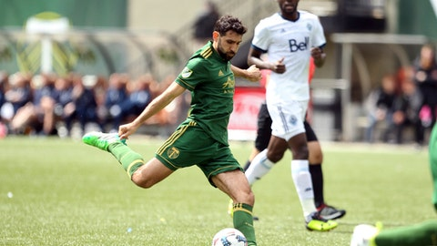 FILE - In this April 22, 2017, file photo, Portland Timbers' Diego Valeri, foreground, lines up a shot during an MLS soccer game against the Vancouver Whitecaps, in Portland, Ore. Timbers midfielder Diego Valeri has been named Major League Soccer's Most Valuable Player. The 31-year-old native of Argentina had 21 goals and 11 assists this season for Portland, which finished atop the Western Conference. He is the first midfielder in league history with 20 or more goals in a single season and just the second player with at least 20 goals and 10 assists in a single season. His 32 combined goals and assists rank fifth in MLS history.(Pete Christopher/The Oregonian via AP, File)
