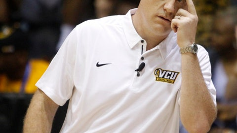 FILE - In this Nov. 20, 2017, file photo, Virginia Commonwealth head coach Mike Rhoades looks on as his team takes on Marquette during the first half of an NCAA college basketball game, in Lahaina, Hawaii. VCU coach Mike Rhoades is looking forward to seeing old friend Shaka Smart on Tuesday night, Dec. 5, 2017,  perhaps more than being on opposing benches when the former VCU coach brings Texas to the Seigel Center. (AP Photo/Marco Garcia, File)