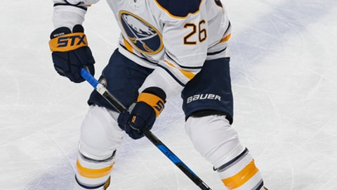 FILE - In this April 8, 2017, file photo, Buffalo Sabres left wing Matt Moulson (26) skates prior to an NHL hockey game against the Florida Panthers, in Sunrise, Fla.  The Buffalo Sabres are shaking up their underachieving roster by placing forward Matt Moulson on waivers and acquiring forward Scott Wilson in a trade with the Detroit Red Wings. (AP Photo/Joel Auerbach, File)