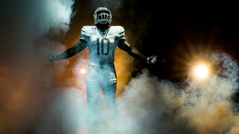 In this Nov. 8, 2017, photo provided by Nike, West Point's Army football uniform made by Nike is modeled. Army will be wearing the new uniform honoring the 10th Mountain Division formed in 1943 at Camp Hale, Colorado, when it plays Navy this weekend. (Nike/Dustin Satloff via AP)