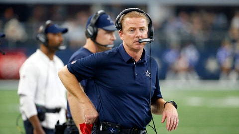 In this Thursday, Nov. 23, 2017 file photo, Dallas Cowboys head coach Jason Garrett watches play from the sideline during an NFL football game against the Los Angeles Chargers in Arlington, Texas. Jason Garrett dislikes comparisons, so the Dallas coach had no interest in recalling the motivation for his Cowboys when he debuted with a win at the New York Giants six days after the firing of Wade Phillips in 2010. (AP Photo/Roger Steinman, File)
