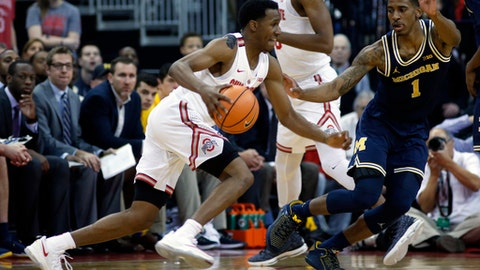Ohio State's C.J. Jackson, left, drives to the basket against Michigan's Charles Matthews during the first half of an NCAA college basketball game Monday, Dec. 4, 2017, in Columbus, Ohio. (AP Photo/Jay LaPrete)