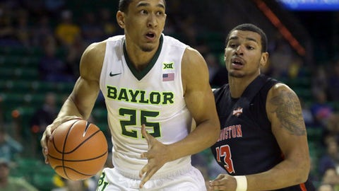 Baylor forward Tristan Clark (25) drives past Sam Houston State forward Bubba Furlong during the first half of an NCAA college basketball game in Waco, Texas, Monday, Dec. 4, 2017. (AP Photo/LM Otero)