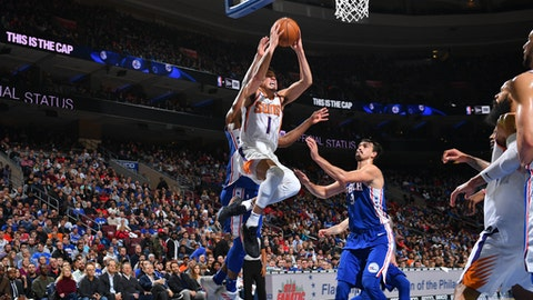 PHILADELPHIA, PA - DECEMBER 4: Devin Booker #1 of the Phoenix Suns goes to the basket against the Philadelphia 76ers on December 4, 2017 at Wells Fargo Center in Philadelphia, Pennsylvania. NOTE TO USER: User expressly acknowledges and agrees that, by downloading and or using this photograph, User is consenting to the terms and conditions of the Getty Images License Agreement. Mandatory Copyright Notice: Copyright 2017 NBAE (Photo by Jesse D. Garrabrant/NBAE via Getty Images)