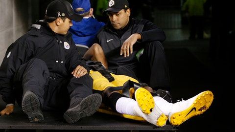 Pittsburgh Steelers inside linebacker Ryan Shazier, in yellow, is carted off the field after an injury in the first half of an NFL football game against the Cincinnati Bengals, Monday, Dec. 4, 2017, in Cincinnati. (AP Photo/Frank Victores)