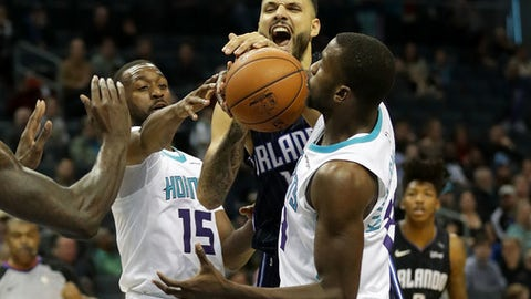 CHARLOTTE, NC - DECEMBER 04:  Evan Fournier #10 of the Orlando Magic runs into teammates Kemba Walker #15 and Michael Kidd-Gilchrist #14 of the Charlotte Hornets during their game at Spectrum Center on December 4, 2017 in Charlotte, North Carolina.  NOTE TO USER: User expressly acknowledges and agrees that, by downloading and or using this photograph, User is consenting to the terms and conditions of the Getty Images License Agreement.  (Photo by Streeter Lecka/Getty Images)