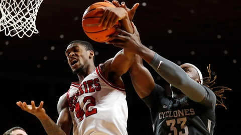 Northern Illinois guard Levi Bradley (42) fights for a rebound with Iowa State forward Solomon Young (33) during the first half of an NCAA college basketball game, Monday, Dec. 4, 2017, in Ames, Iowa. (AP Photo/Charlie Neibergall)