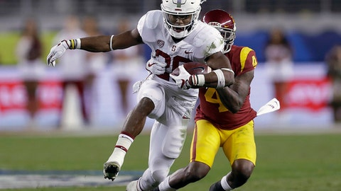 FILE - In this Dec. 1, 2017, file photo, Stanford running back Bryce Love (20) runs in front of Southern California safety Chris Hawkins (4) during the first half of the Pac-12 Conference championship NCAA college football game in Santa Clara, Calif. Love, Louisville's Lamar Jackson and Oklahoma's Baker Mayfield were chosen as finalists for the Heisman Trophy on Monday, Dec. 4, 2017. (AP Photo/Marcio Jose Sanchez, File)