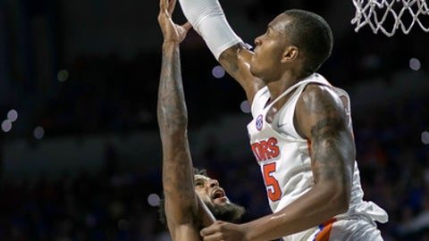 Florida State forward Phil Cofer's (0) shot is blocked by Florida forward Keith Stone (25) during the first half of an NCAA college basketball game in Gainesville, Fla., Monday, Dec. 4, 2017. (AP Photo/Ron Irby)