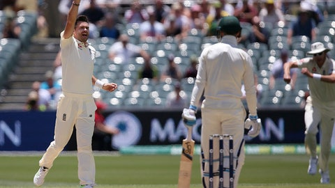 England's James Anderson, left, celebrates while believing he has taken the wicket of Australia's Peter Handscomb only to have it overturned by review during the fourth day of their Ashes cricket test match in Adelaide, Tuesday, Dec. 5, 2017. (AP Photo/Rick Rycroft)