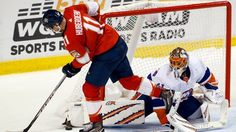 New York Islanders goalie Jaroslav Halak, right, blocks a shot from Florida Panthers left wing Jonathan Huberdeau (11) during a shootout at an NHL hockey game, Monday, Dec. 4, 2017, in Sunrise, Fla. (AP Photo/Wilfredo Lee)