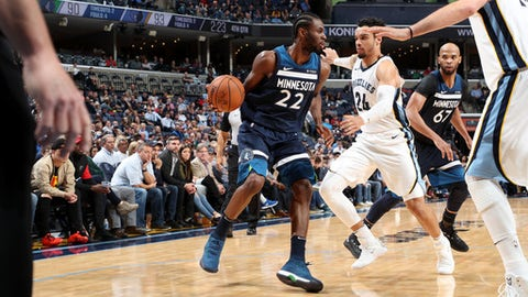 MEMPHIS, TN - DECEMBER 4: Andrew Wiggins #22 of the Minnesota Timberwolves handles the ball during the game against the Memphis Grizzlies on December 4, 2017 at FedEx Forum in Memphis, Tennessee. NOTE TO USER: User expressly acknowledges and agrees that, by downloading and/or using this photograph, user is consenting to the terms and conditions of the Getty Images License Agreement. Mandatory Copyright Notice: Copyright 2017 NBAE (Photo by Joe Murphy/NBAE via Getty Images)