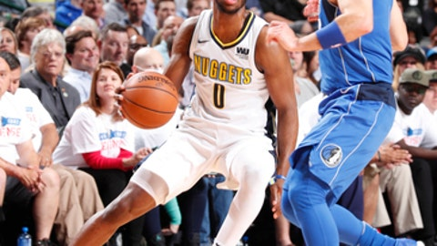 DALLAS, TX - DECEMBER 4: Emmanuel Mudiay #0 of the Denver Nuggets handles the ball against the Dallas Mavericks on December 4, 2017 at the American Airlines Center in Dallas, Texas. NOTE TO USER: User expressly acknowledges and agrees that, by downloading and or using this photograph, User is consenting to the terms and conditions of the Getty Images License Agreement. Mandatory Copyright Notice: Copyright 2017 NBAE (Photo by Danny Bollinger/NBAE via Getty Images)