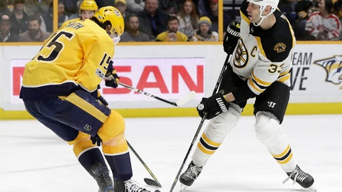 Boston Bruins defenseman Zdeno Chara (33), of Slovakia, scores a goal past Nashville Predators right wing Craig Smith (15) in the third period of an NHL hockey game Monday, Dec. 4, 2017, in Nashville, Tenn. The Predators won 5-3. (AP Photo/Mark Humphrey)