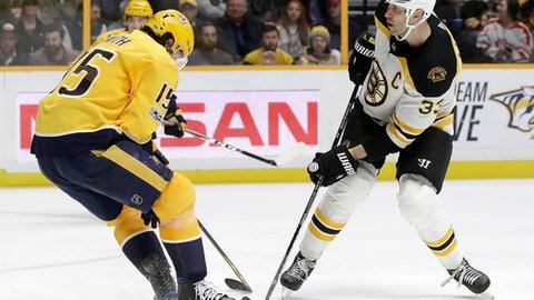 Boston Bruins defenseman Zdeno Chara (33), of Slovakia, scores a goal past Nashville Predators right wing Craig Smith (15) in the third period of an NHL hockey game Monday, Dec. 4, 2017, in Nashville, Tenn. The Predators won 5-3. (AP Photo/Mark Humphrey)