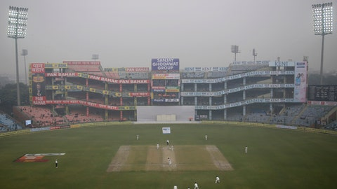 Floodlights are on as the fog envelops Ferozshah Kotla ground during the fourth day of third test cricket match between India and Sri Lanka in New Delhi, India, Tuesday, Dec. 5, 2017. (AP Photo/Altaf Qadri)