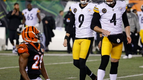 Pittsburgh Steelers kicker Chris Boswell (9) celebrates his game-winning field goal alongside punter Jordan Berry (4) as Cincinnati Bengals cornerback Josh Shaw, left, kneels on the field in the second half of an NFL football game, Monday, Dec. 4, 2017, in Cincinnati. The Steelers won 23-20. (AP Photo/Frank Victores)