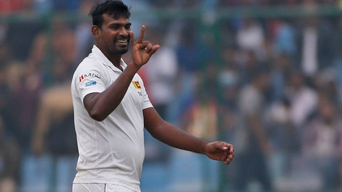 Sri Lanka's Lahiru Gamage gestures after dismissing India's captain Virat Kohli during the fourth day of their third test cricket match in New Delhi, India, Tuesday, Dec. 5, 2017. (AP Photo/Altaf Qadri)