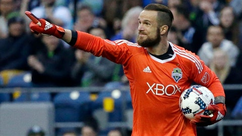 FILE - In this March 31, 2017, file photo, Seattle Sounders goalkeeper Stefan Frei directs his teammates during an MLS soccer match against Atlanta United in Seattle. Stefan Frei will at some point this week enter a social media blackout. Until then, the Sounders goalkeeper is going to see plenty of replays of his memorable save from last year's MLS Cup as the Sounders prepare for the rematch with Toronto. (AP Photo/Ted S. Warren, File)