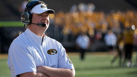 FILE - In this April 16, 2016, file photo, Missouri offensive coordinator Josh Heupel watches his team play during an NCAA college spring football game in Columbia, Mo. Heupel, who has been the offensive coordinator/quarterbacks coach at Missouri the past two seasons, was hired Tuesday, Dec. 5, 2017, as UCF's new football coach. The 39-year-old Heupel replaces Scott Frost, who accepted the Nebraska head coaching job after leading UCF to a 12-0 record and the American Athletic Conference title.  (AP Photo/L.G. Patterson, File)