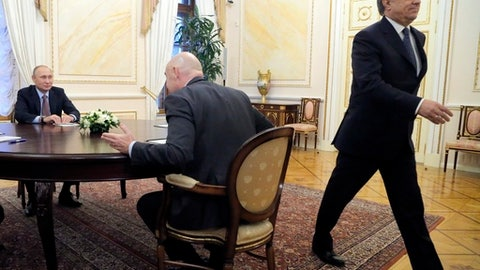FILE - In this pool photo taken on Friday, Nov. 25, 2016 Russian President Vladimir Putin, left, listens to FIFA President Gianni Infantino, center, as Vitaly Mutko, deputy premiership in charge of sport, tourism and youth policies, right, walks out during their meeting in the Kremlin in Moscow, Russia. On Tuesday, Dec. 5, 2017 IOC imposed a lifetime Olympic ban on Mutko. (Maxim Shipenkov/Pool Photo via AP)