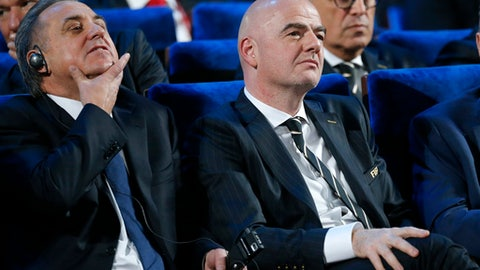 FILE - In this Dec. 1, 2017 file photo FIFA president Gianni Infantino, right, and Vitaly Mutko, Russian Federation Deputy Prime Minister & Local Organising Committee Chairman attend the 2018 soccer World Cup draw in the Kremlin in Moscow. On Tuesday, Dec. 5, 2017 IOC imposed a lifetime Olympic ban on Mutko. (AP Photo/Alexander Zemlianichenko, file)