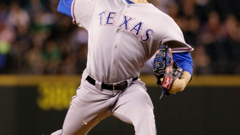 Texas Rangers starting pitcher Miles Mikolas throws against the Seattle Mariners in the sixth inning of a baseball game Monday, Aug. 25, 2014, in Seattle. (AP Photo/Elaine Thompson)