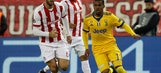 Juventus beats Olympiakos 2-0 to advance in Champions League