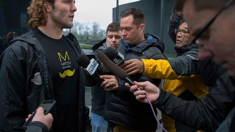Oregon football player Brady Breeze talks to the media after  a team meeting at the Hatfield-Dowlin Complex in Eugene, Ore. Tuesday, Dec. 5, 2017. Oregon head coach Willie Taggart told the team that he had accepted the head coaching job at Florida State, leaving the Ducks in search of a head coach. (Brian Davies/The Register-Guard via AP)