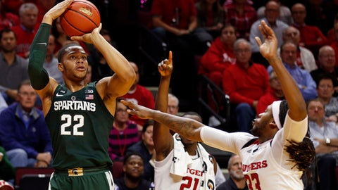 Michigan State guard Miles Bridges (22) shoots over Rutgers forward Deshawn Freeman, right, during the first half of an NCAA college basketball game Tuesday, Dec. 5, 2017, in Piscataway, N.J. (AP Photo/Adam Hunger)